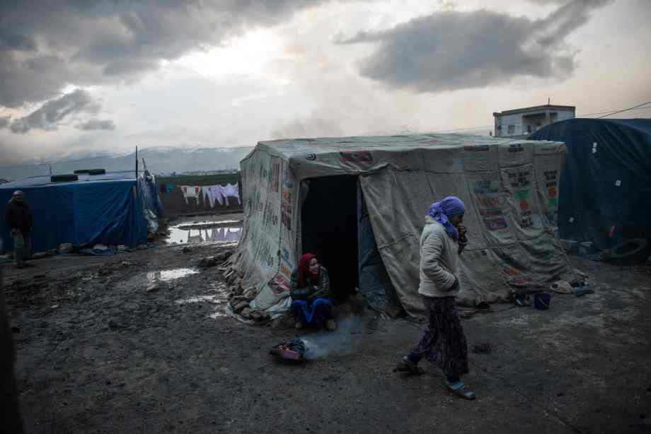 Syrian refugees live in the shell of a bombed-out factory in the Bekaa valley, Lebanon